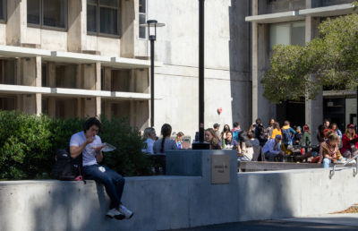 photo of students sitting on campus