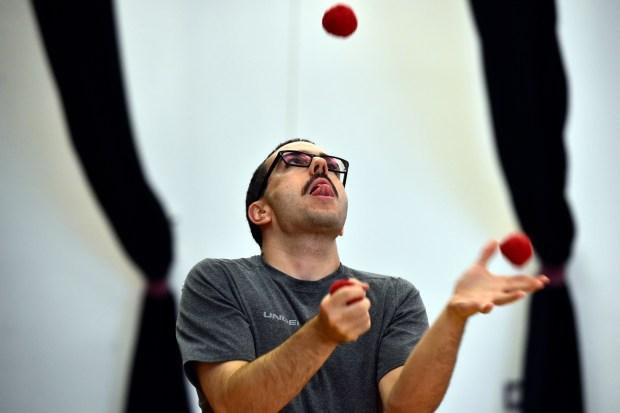 Chris Ransom, of Denver, juggles three ...