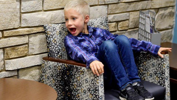 Beaudin Larrabee, 7, reacts to seeing ...