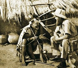 Talking with a pygmy shaman in Africa. The pho...