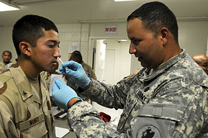 Army Sgt. Felepie Rodriguez, a medic assigned to Joint Task Force Guantanamo's Joint Trooper Clinic, administers an intranasal flu vaccination to Navy Petty Officer 3rd Class Esteban Nunez, September 13, 2010.The JTC is conducting annual influenza vaccinations for JTF Guantanamo service members. (JTF Guantanamo photo by U.S. Navy Mass Communication Specialist 2nd Class Elisha Dawkins) (Photo credit: Wikipedia)