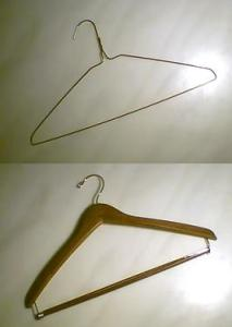 Wire (top) and wooden (bottom) clothes hangers (Photo credit: Wikipedia)