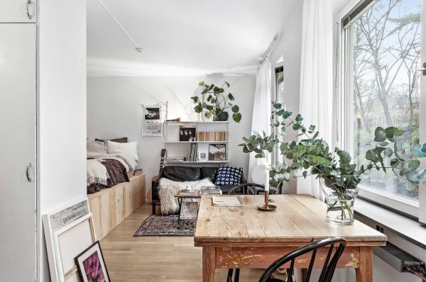 small apartment bedroom idea Tiny dreamy studio apartment with a raised bed - Daily