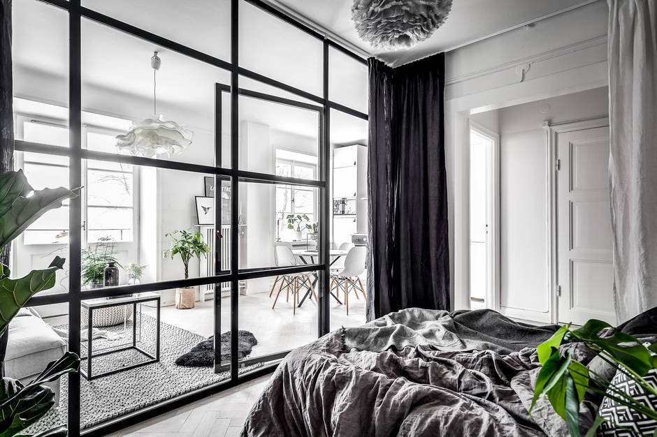 A small  dreamy Scandinavian apartment with a glass wall