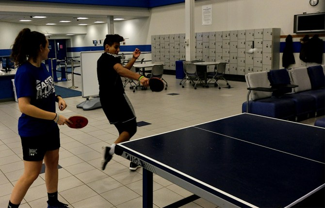 Ixtaso Agüero Campanon, a exercise science major, and Daniela Vermeo, a freshman sports management major, play table tennis Thursday night in Lantz Arena.