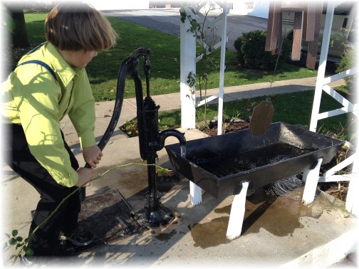 Amish boy with well pump 10/17/14