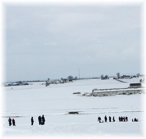 Children sledding in snow 1/29/16