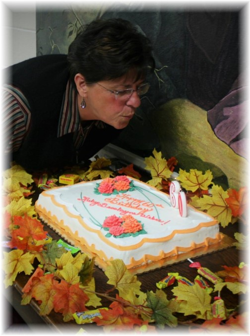Brooksyne blowing out her 60th birthday cake 10/25/15