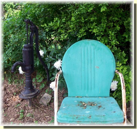 Old water pump & chair