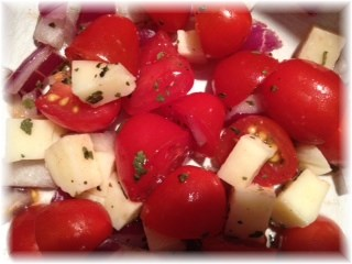Tomatoes with mozzarela, basil