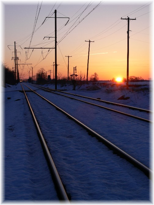 Train coming at sunrise (Photo by John Heisey)