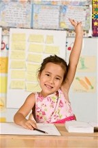 Little girl raising hand