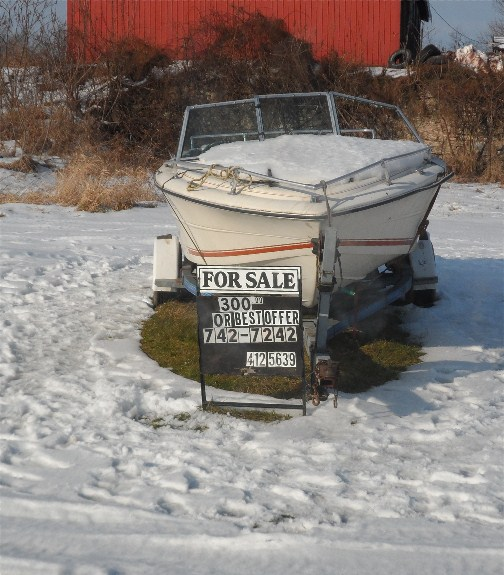 Boat for sale in snow