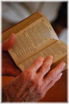 Elderly hands reading Bible