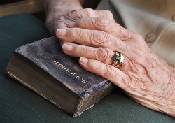 Old hands on old Bible