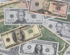 Dollar Slides on Fed Comments