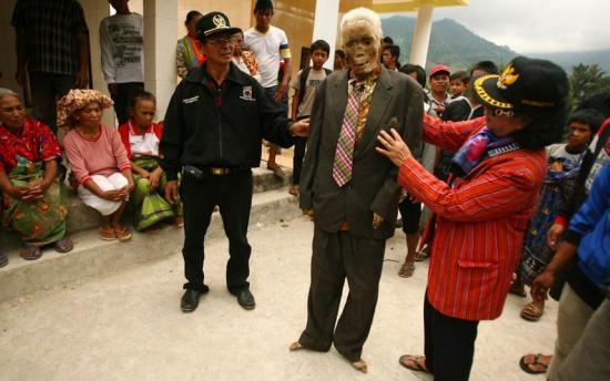 Toraja people dressing one of their deceased family members