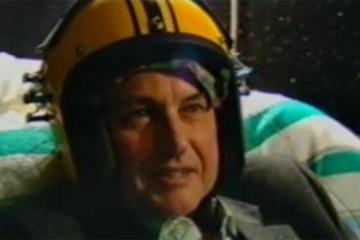Richard Dawkins wears the God Helmet