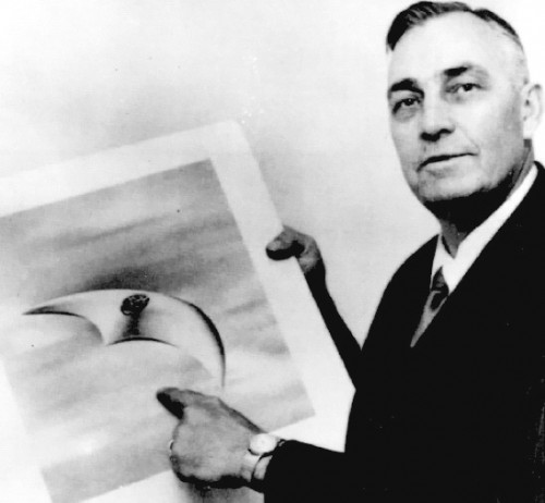 Kenneth Arnold showing crescent-shaped UFO in 1952