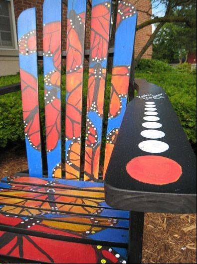paint for adirondack chairs slipcovered dining chair wauconda storeowners use art project as downtown one of the painted sits along main street in