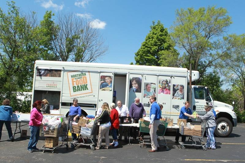 executive chair manufacturers covers northern ireland event helps illinois food bank solve hunger