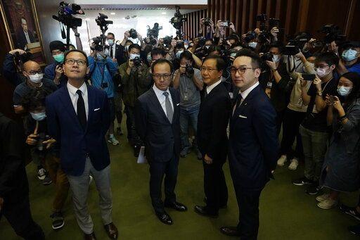 Hong Kong's pro-democracy lawmakers resign en masse