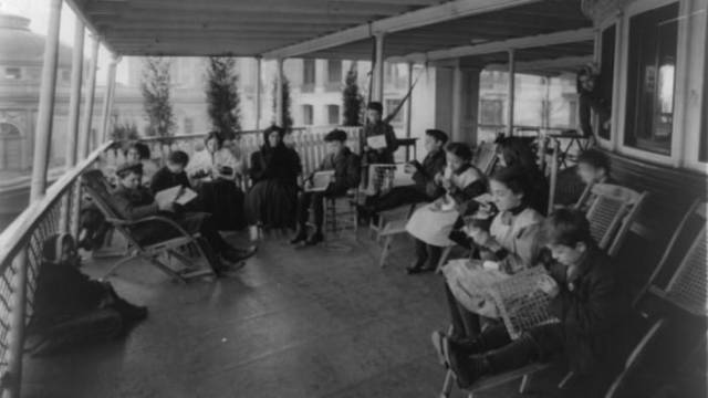 Outdoor class in hands-on training on the Southfield boat at Bellevue Hospital in New York City, which turned ferry barges into floating rooms to fight tuberculosis.