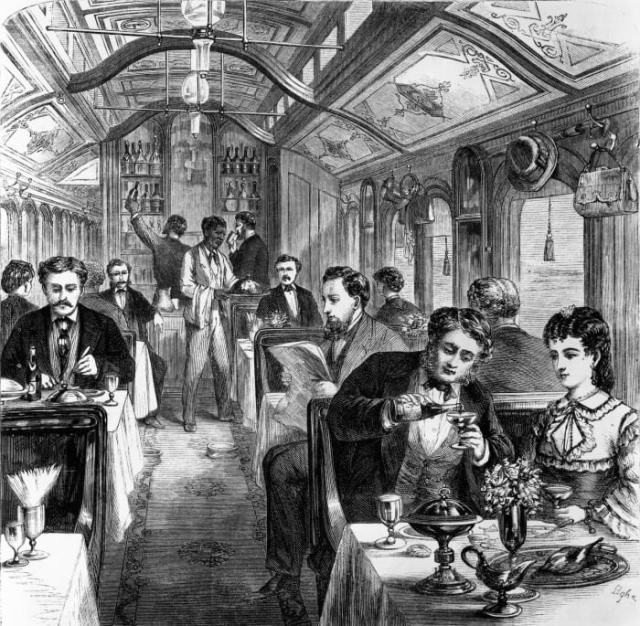 Passengers traveling across the continent in the Pacific Railroad dining car, circa 1870.