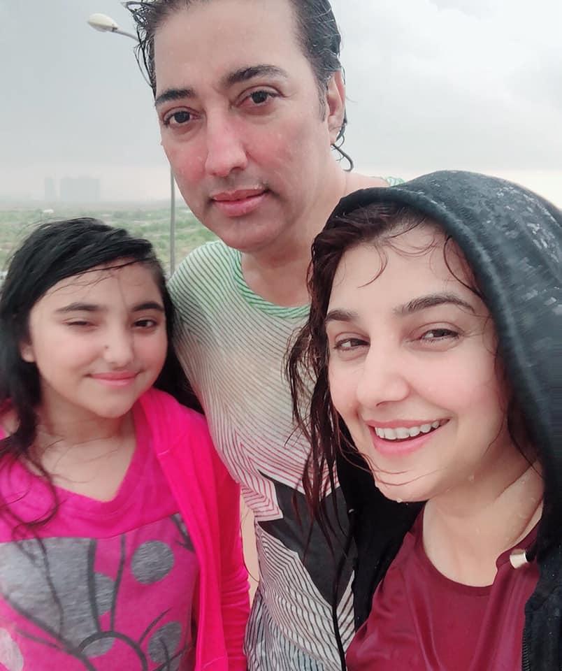 Javeria and Saud Enjoying Rain at their Home in Karachi