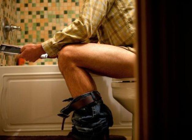 Man-sitting-on-toilet