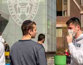 NEW YORK, NY - MARCH 4:  A Yeshiva student wears a face mask on the grounds of the university on March 4, 2020 in New York City. A Yeshiva student has tested positive for Covid-19. The student's father was the second person to test positive for Covid-19 in New York and is currently hospitalized. (Photo by David Dee Delgado/Getty Images)