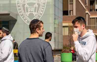 NEW YORK, NY - MARCH 4:  A Yeshiva student wears a face mask on the grounds of the university on March 4, 2020 in New York City. A Yeshiva student has tested positive for Covid-19. The student's father was thesecond personto testpositive for Covid-19 in New York and is currently hospitalized. (Photo by David Dee Delgado/Getty Images)