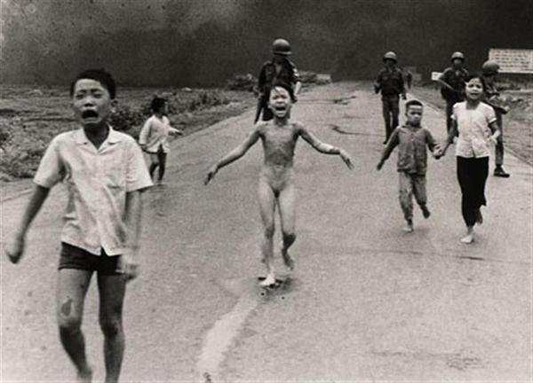 Taken by Nick Ut, who won pulitzer prize for this picture. This Picture was taken during the south Vietnamese attack during 1972. The Girl running towards the camera is safe and still alive.