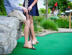 Couple Playing Mini-Golf