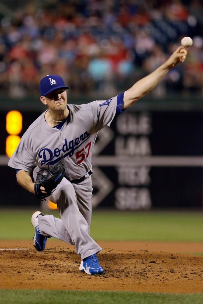Los Angeles Dodgers' Alex Wood pitches during the first inning of a baseball game against the Philadelphia Phillies, Wednesday, Sept. 20, 2017, in Philadelphia. (AP Photo/Matt Slocum)