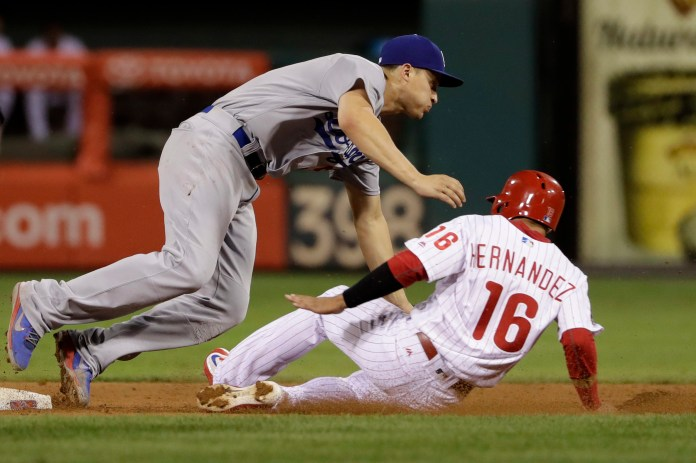 Philadelphia Phillies' Cesar Hernandez, right, collides with Los Angeles Dodgers shortstop Corey Seager at second base on a ball hit by Freddy Galvis during the eighth inning of a baseball game, Wednesday, Sept. 20, 2017, in Philadelphia. Philadelphia won 7-5. (AP Photo/Matt Slocum)