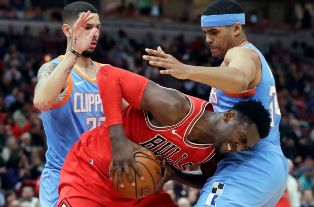 Chicago Bulls forward Bobby Portis, center, drives against is fenced in by Clippers guard Austin Rivers, left, and forward Tobias Harris during the second half of Tuesday's game in Chicago. The Clippers won 112-106. (AP Photo/Nam Y. Huh)