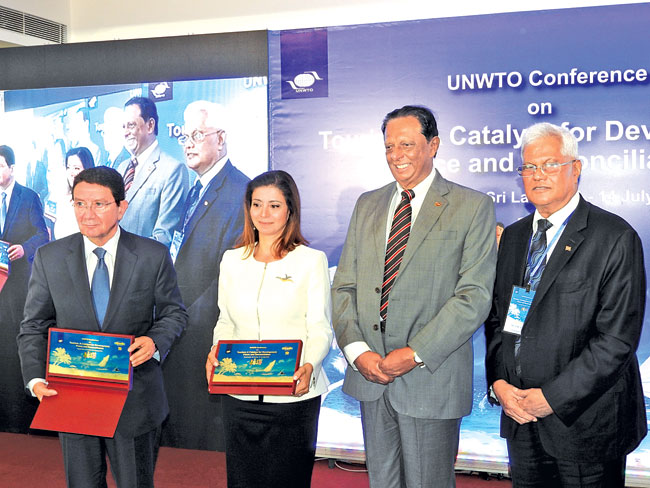 Tourism Minister John Amaratunge with UNWTO Secretary GeneralTaleb Rifai, Petra National Trust of Jordan Chair Princess Dana Firas and Sri Lanka Tourism Chairman Paddy Withana at the WTO Summit at the Amaya Hotel in Passikudah.  Picture by Shirajiv Sirimane.