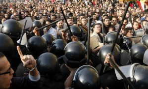 Demonstrators clash with police in central Cairo during a protest to demand the ouster of President Hosni Mubarak and calling for reforms on 25 January (AFP Photo / Mohammed Abed)