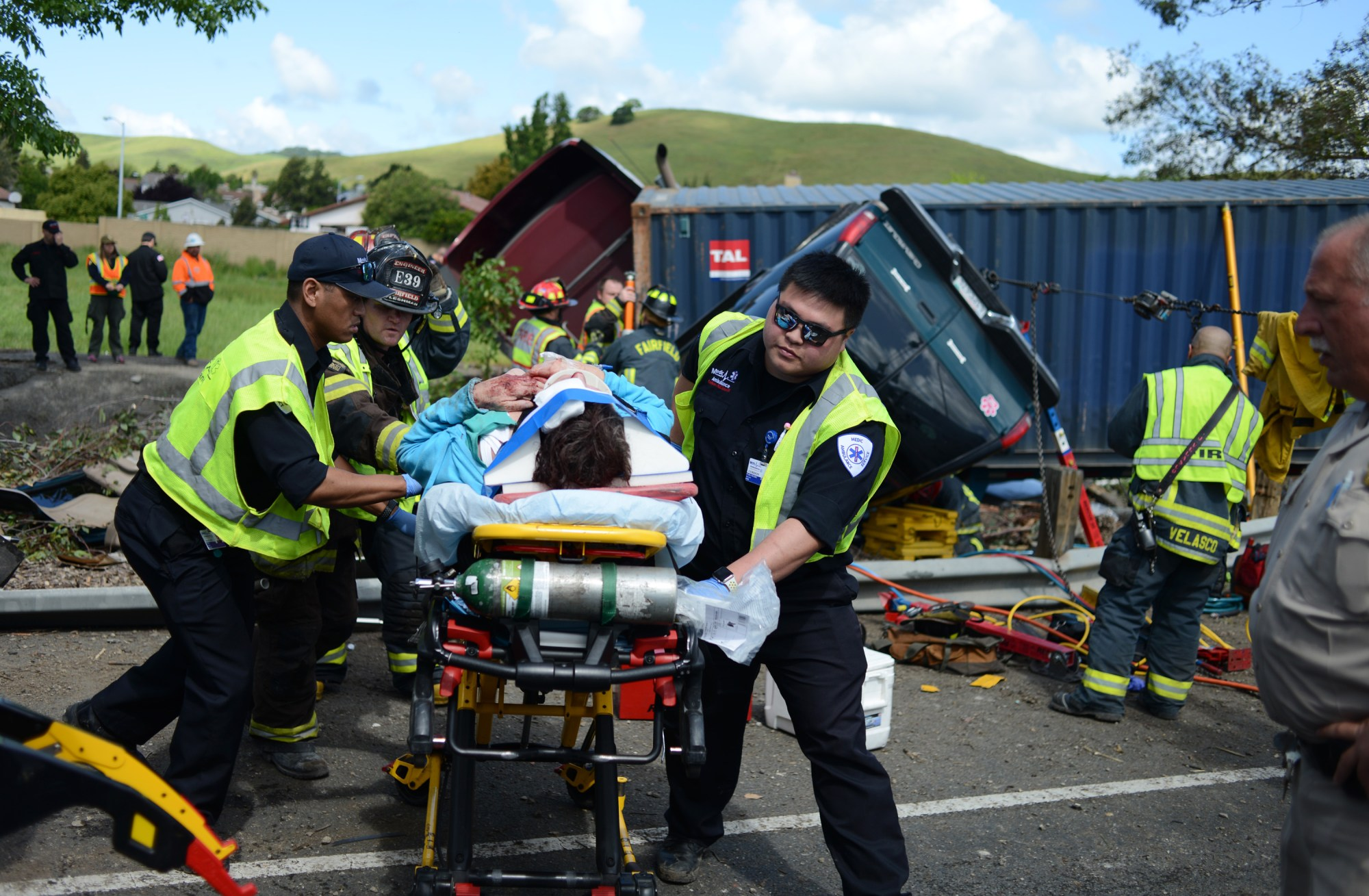 hight resolution of emergency officials transport a victim to an ambulance after a four vehicle pileup along westbound interstate 80 just east of the air base parkway exit in