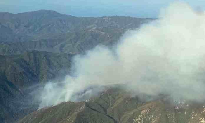 Hundreds of firefighters battle blaze raging in California