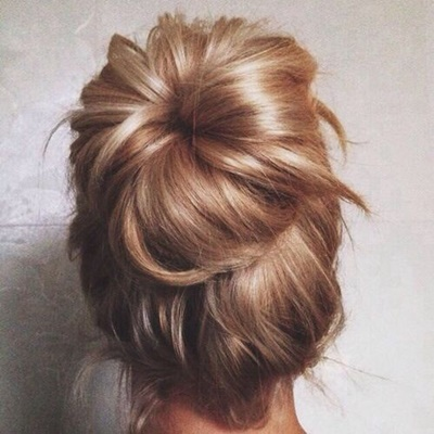#3 If the hair is too long to handle, make a bun. Tying you hair into a bun with nylon stockings keeps it smooth and light.