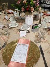 Peach and floral themed VIP table setting at LGBTQ+ wedding show