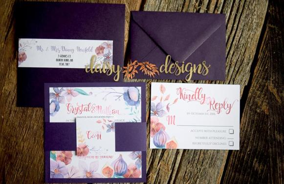 violet femme wedding invitation layered on grape coloured paper with bely band and monogram, rsvp and matching envelopes