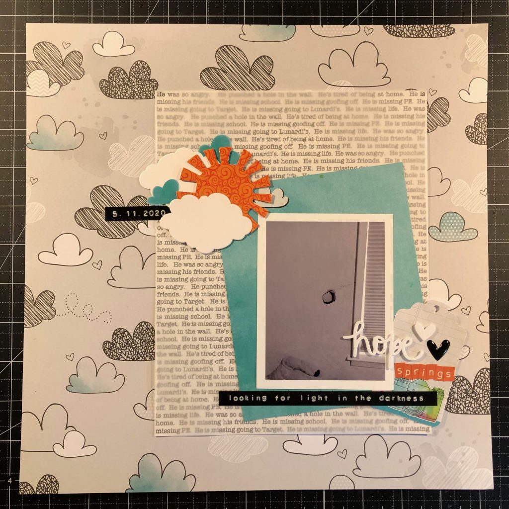Scrapbook layout of the hole in my son's wall.