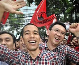 Pasangan Jokowi-Ahok yang diusung oleh PDIP dan Partai Gerindra saat Pilgub DKI Jakarta. (Antara/Yudhi Mahatma)