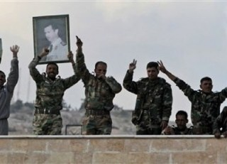 Pasukan Suriah membawa poster Presiden Suriah, Bashar Al-Assad (inet)
