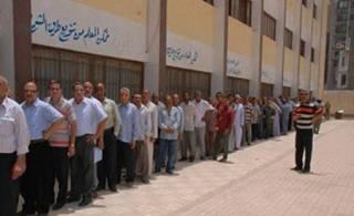 """TPS di sebuah sekolah di Doki. Situs """"Bawwabah Qahirah"""" menyebutnya sebagai bukti referendum hari ini ramai didatangi warga. Padahal foto yang dipasang menunjukkan situasi musim panas, bukan sekarang (shuqur ishlah)"""