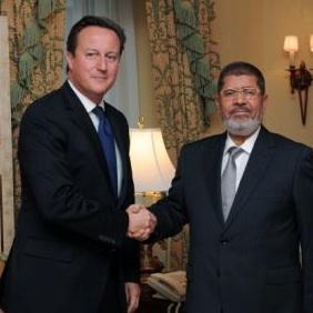 Perdana Menteri Inggris David Cameron dan Presiden Mursi (stopwar.org.uk)