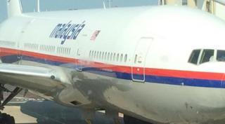 Foto MH17 yang diposting oleh penumpang asal Belanda Cor Pan dihalaman Facebook nya. (liputan6.com)